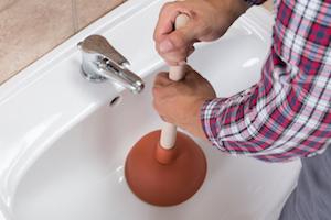 Unclogging a bathroom sink
